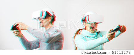 Man and woman with virtual reality headset are playing game. Image with glitch effect. 61313278