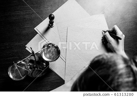 Notary woman writing by the pen on the documents 61313280
