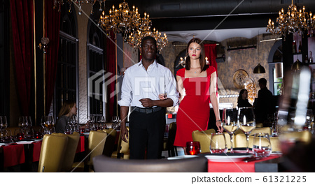 African-american man with elegant woman in red dress in fashionable restaurant 61321225