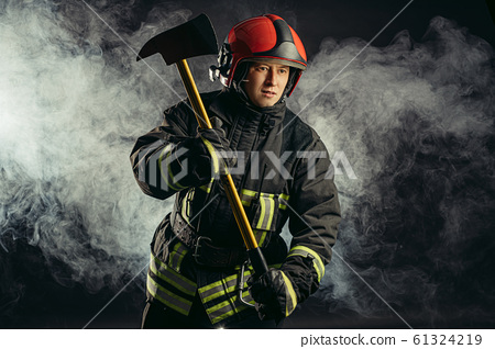 portrait of fireman with hammer 61324219