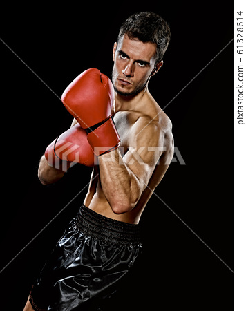 caucasian young boxer boxing man portrait waist up isolated black background 61328614
