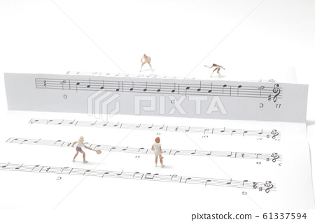 a mini figure play the tennis on the music notes 61337594