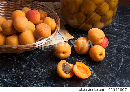 Fresh organic harvested apricots in basket and big 61342807
