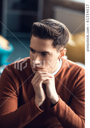 Handsome man feeling thoughtful while having too much work 61354017