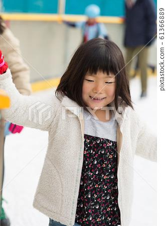Girl enjoying ice skating 61366889