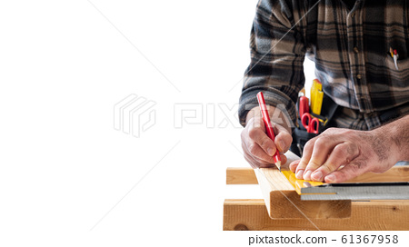 Carpenter at work on wooden boards. Carpentry. 61367958