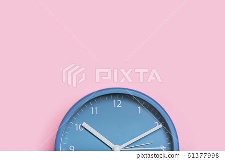 Cropped image of clock on pink background. 61377998