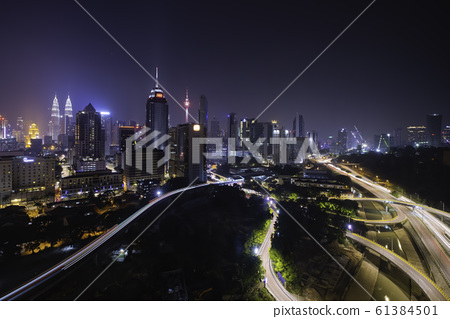 Kuala lumpur skyline at night with car light trail 61384501
