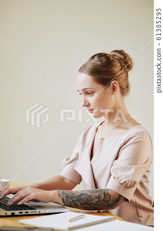 Pensive Woman Working in Office 61385295