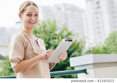Businesswoman With Pad Portrait 61385823