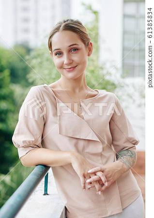 Elegant Woman On Balcony 61385834
