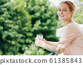 Young Woman With Cup Of Coffee 61385843