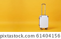 White luggage bag isolated on yellow background 61404156