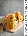 Refreshing and healthy mango smoothie in glasses.. 61407770