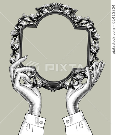 Female hands holding a baroque decorative frame 61415804