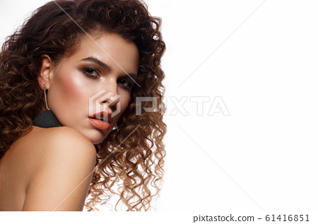Beautiful sexy girl with bright makeup and curls hair. Beauty face. 61416851