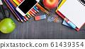 School supplies on blackboard background 61439354
