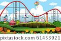 Scene with roller coaster and other rides in the 61453921