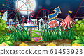 Scene with many rides in the fair at night time 61453923