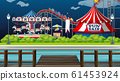 Scene with circus rides by the lake at night time 61453924