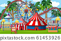 Scene with roller coaster and many rides in the 61453926