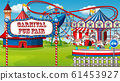 Scene with roller coaster and other rides in the 61453927