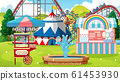 Scene with roller coaster and other rides in the 61453930