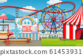 Scene with many rides in the fun fair 61453931