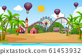 Scene with many circus rides and hot air balloon 61453932