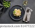 Pasta tagliatelle with  peas and bacon  61477222