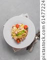 Pasta with trout in white plate 61477224