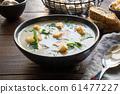 Mushroom champignon cream soup on wooden table. 61477227