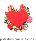 Red heart and colorful sweets, lollipops, licorice 61477233