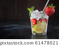 Detox lemonade or mojito with lime and strawberry 61478021
