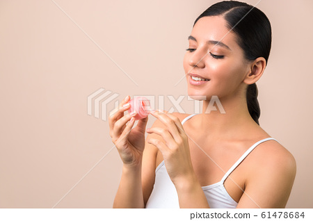 lips care and protection. woman applying lip mask on lips 61478684