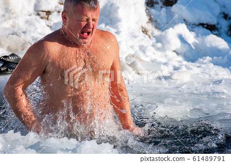 epiphany bathing on a sunny day 61489791