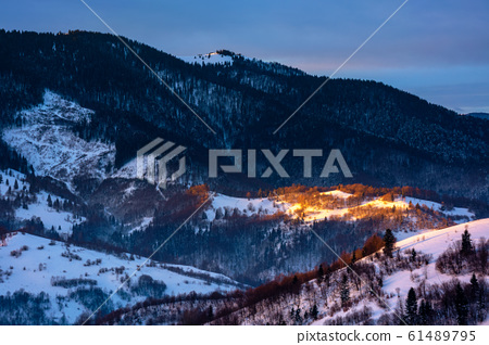 winter countryside scenery at dawn 61489795