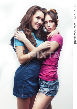 best friends teenage girls together having fun, posing emotional on white background, besties happy smiling, lifestyle people concept 61494976