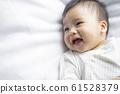baby boy 6 month in bedroom 61528379