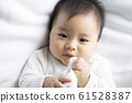 baby boy 6 month in bedroom 61528387