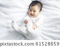 baby boy 6 month in bedroom 61528659