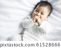 baby boy 6 month in bedroom 61528666
