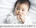 baby boy 6 month in bedroom 61528672