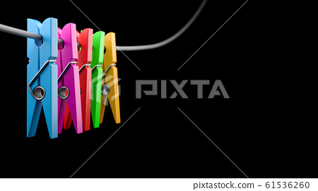 Colorful Clothespins on Black Background 61536260