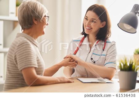 patient listening to doctor 61536438