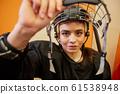 Female Hockey Player Wearing Sports Helmet 61538948