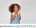 happy little african american girl with backpack 61542612