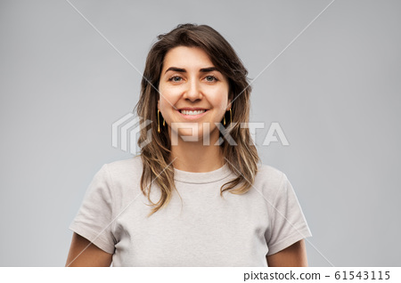 happy smiling young woman in grey t-shirt 61543115