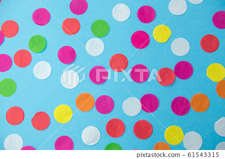 colorful confetti decoration on blue background 61543315
