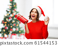 happy young woman in santa hat with red gift box 61544153